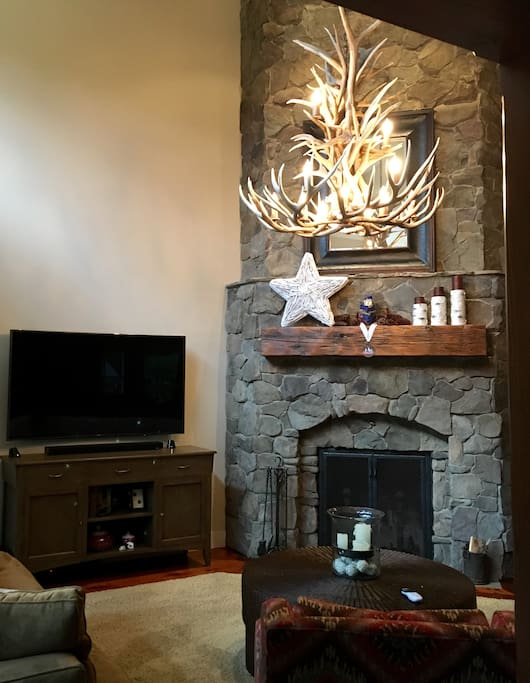 Stone fireplace and one of 4 TV's