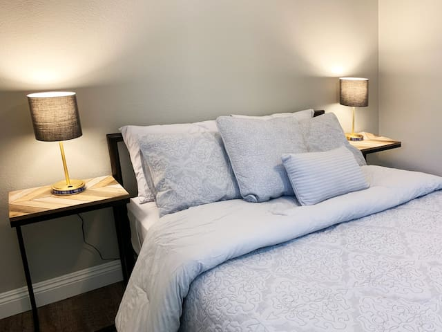 Gorgeous 2nd bedroom with usb lamps to keep you charged all night long!