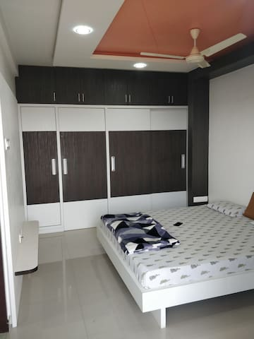 1st floor master bed room with huge cupboard  and attached big balcony.