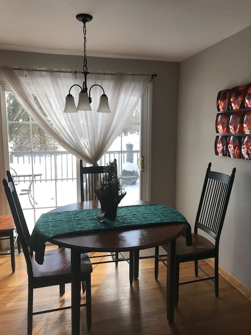 Dining Room (table extends to 6+ seats)  with Doors out to deck.