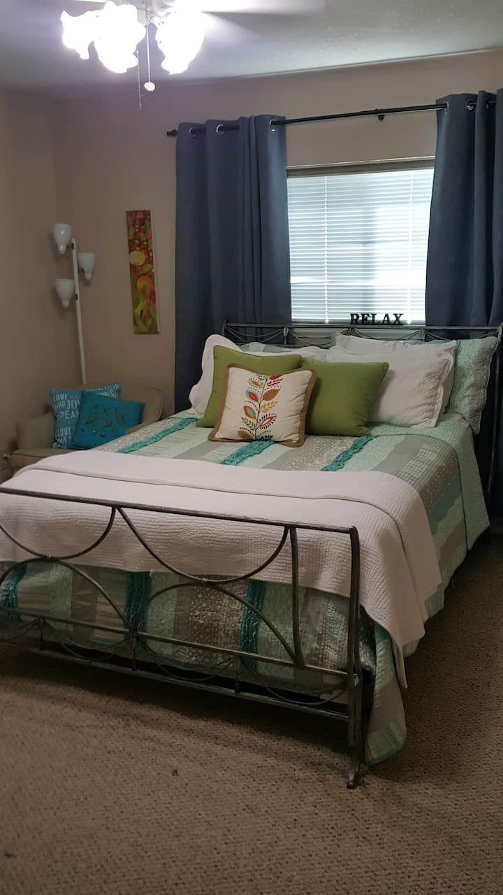 Relaxing, cheerful bedroom extend stay welcome