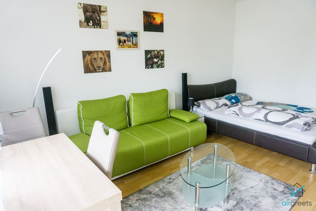 Green color creates a warm atmosphere in the apartment.
