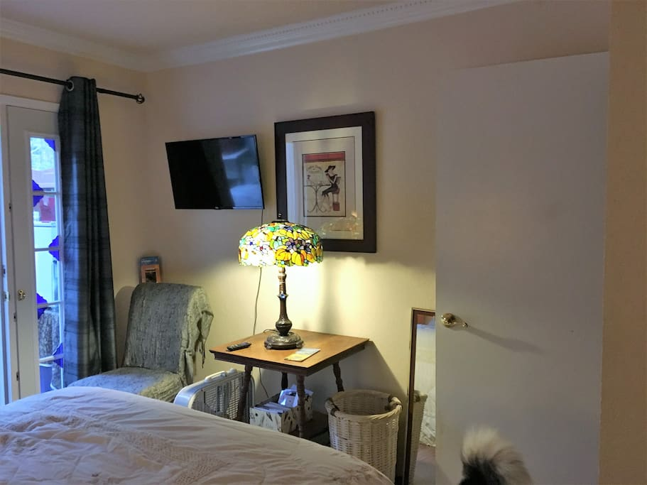 Across from the bed is a small seating area, fan and television. (We offer streaming on netflix, HBO and others)