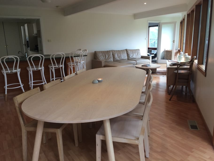 Open plan casual living and dining: new large Jardan dining table and chairs (seats up to 12) and Thonet chairs around the island bench leading on to the large fully equipped kitchen with new dishwasher, pantry, Nespresso machine & pods, T2 teas, kitchen essentials