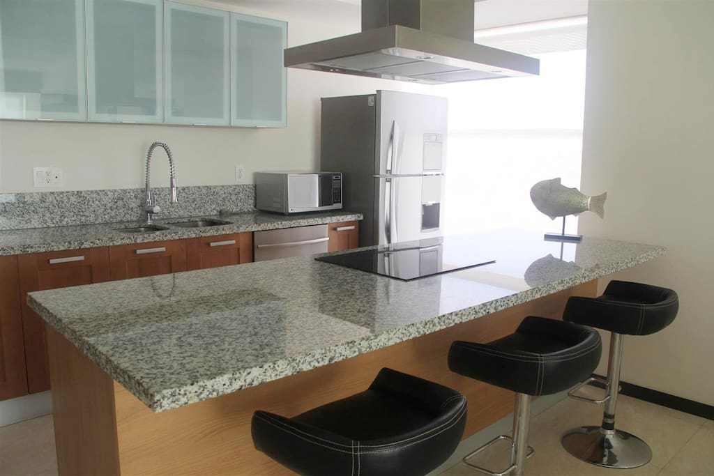 Large kitchen with seating.