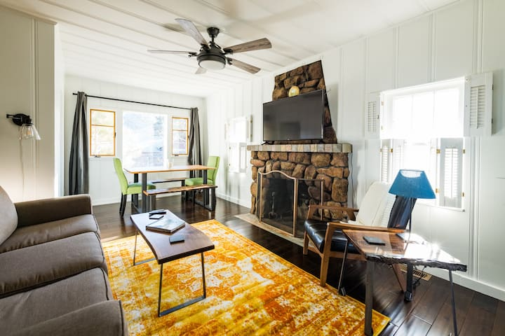 Living/dining room with tons of natural light. *Note: fireplace is sealed and not useable.