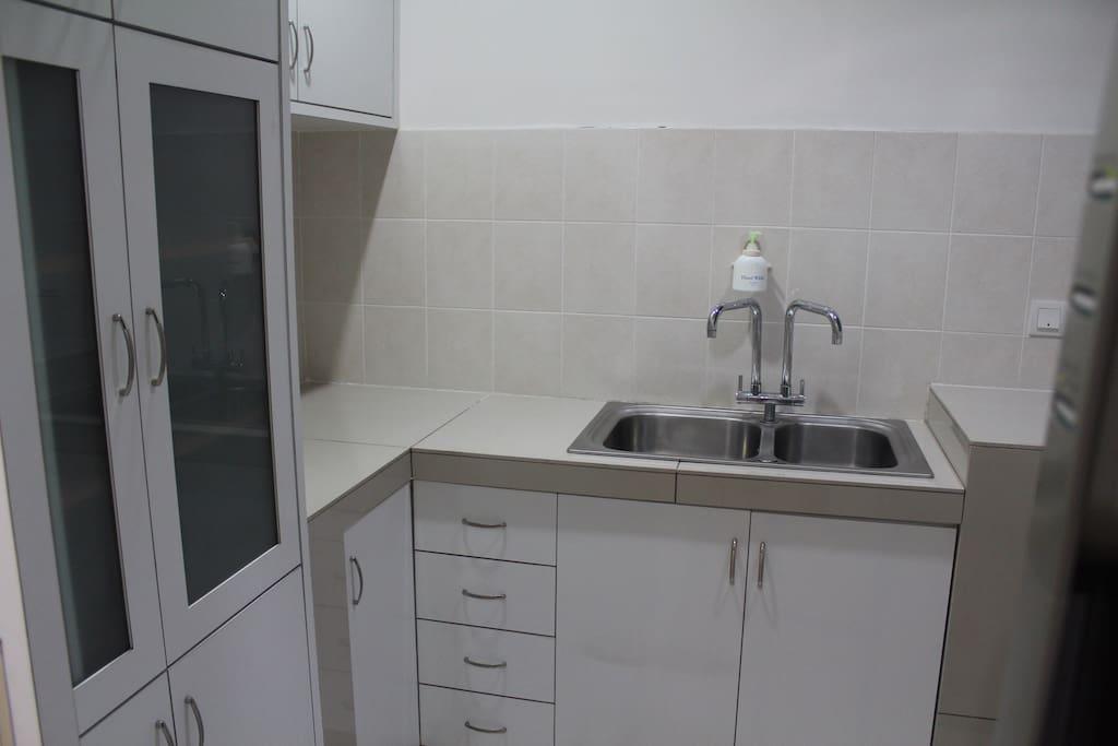 Separate dishwashing and laundry room