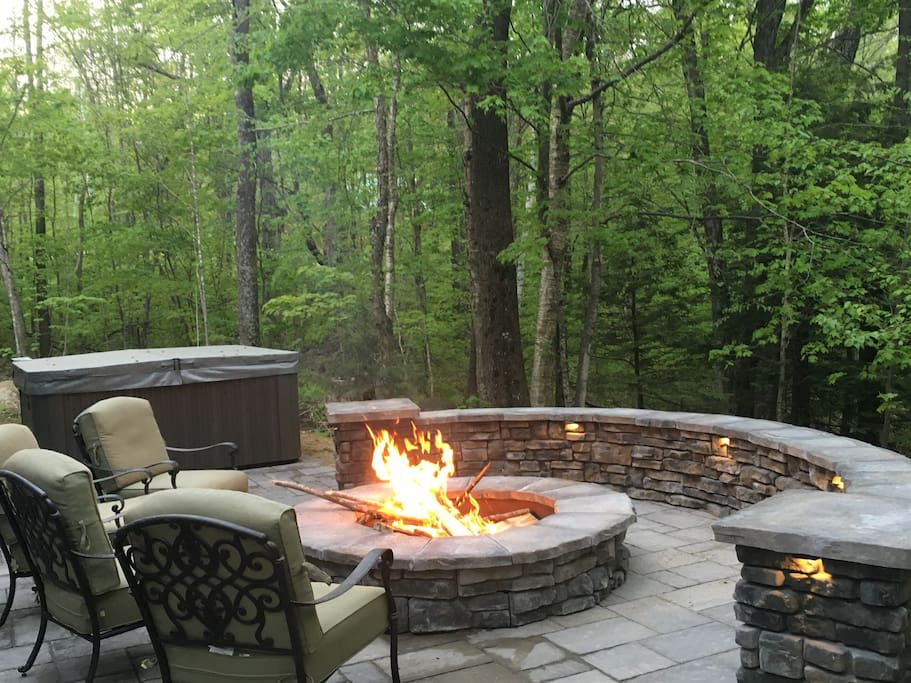 Hot tub and patio with seating wall for cozy evenings with friends and family!