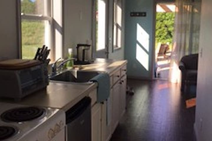 Kitchenette featuring oven, microwave, toaster oven, coffee maker
