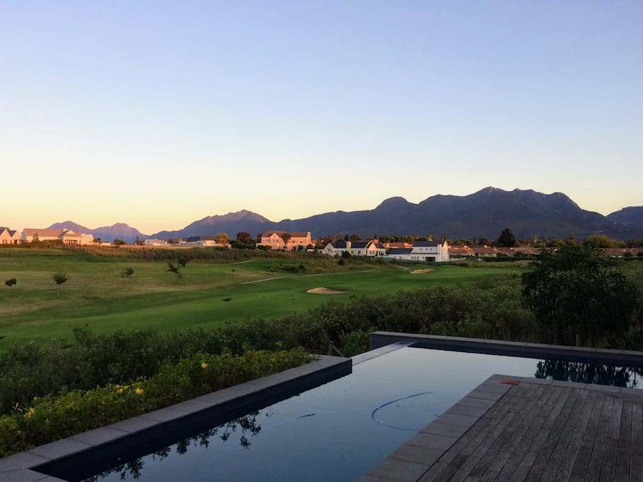 Views of the infinity pool, golf course and mountains