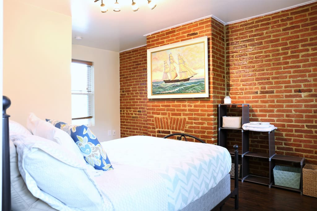 Enjoy the exposed brick, characteristic of historic Baltimore homes! (not pictured) This room now features a desk.