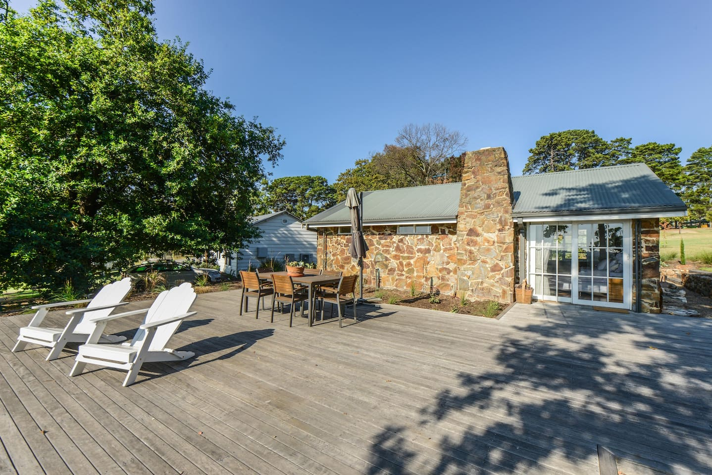 Large deck with views over the vineyard and farm and beyond to the Morninton Peninsula. A great place to watch the sunset and enjoy a glass of wine.