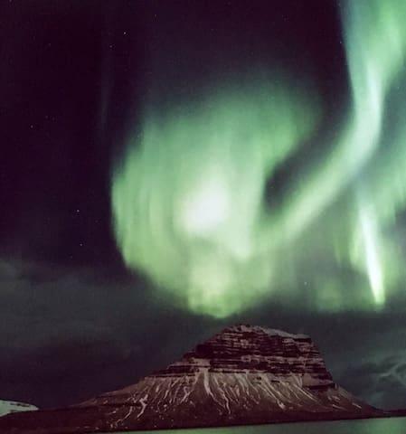 The northern lights dancing around Kirkjufell mountain.