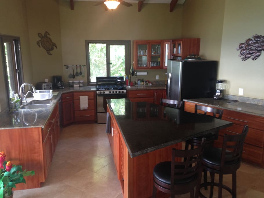 Granite countertop, stainless steel appliances and island seating