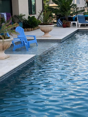 Relax in our Adirondack chairs while cooling your feet in the pool!