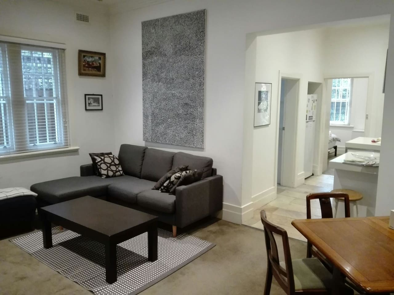 Spacious 70 m2 apartment with an open floor plan living area, two bedrooms, one with attached sunroom and a communal garden