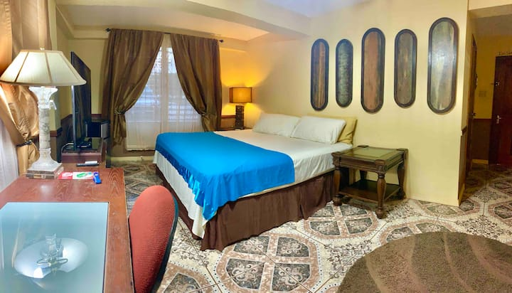Enjoy a Super King-Bed Suite in The City (w/AC)