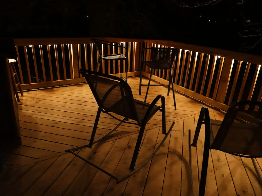 Outdoor deck with bar and firepit access.