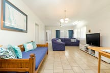 Our main living area is bright and comfortable.   We have a large screen TV and a DVD and BlueRay Player.    There is a selection of books and magazines and a small selection of DVDs.