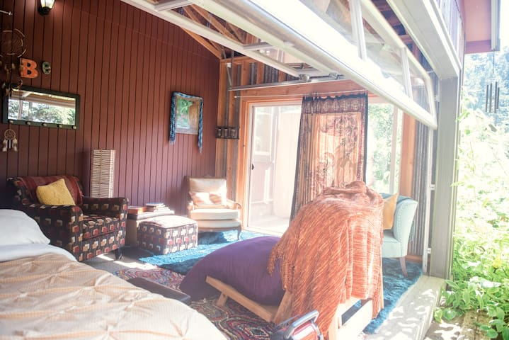 Peaceful private sunroom on 5 forrested acres