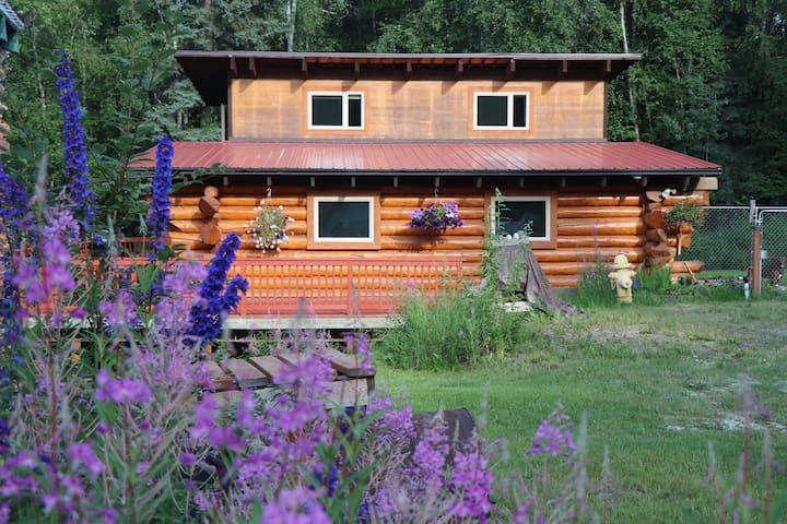 Alaskan log home in the woods