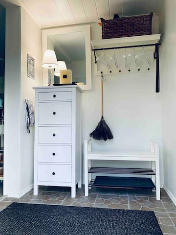 The entrance is cosy and welcoming. It has great storage for your outside clothes. More storage conveniently to your right from the entrance.