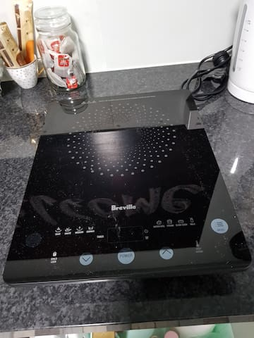 An induction cooktop and scan pan supplied .
