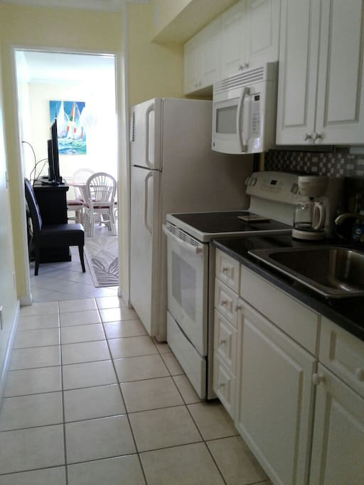 ceramic tile floor and granite counter tops in a well equipped kitchen