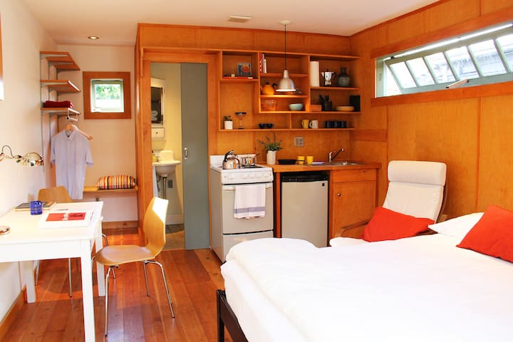 studio with full kitchen and view of bathroom