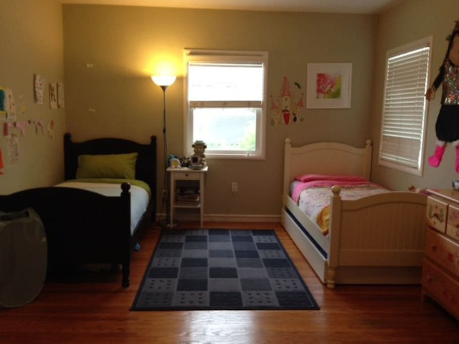Bedroom with two twin beds and additional trundle bed