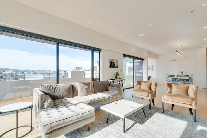 Spacious open-plan living area featuring large glass doors opening onto your own private, wrap-around terrace