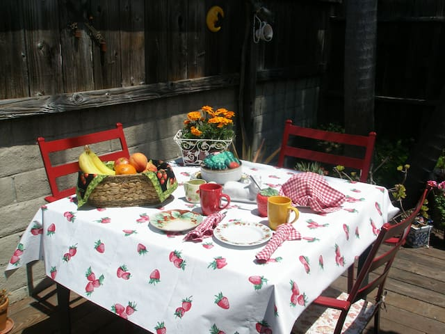 Outside deck dining.  You can bring out your free continental breakfast outside on your private deck!  BBQ is on deck for lunch or dinner! Have an outdoor fire pit for ambiance or to keep warm.  Enjoy some bubbly, coffee or tea. Wood included.