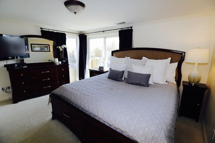 Master bedroom with balcony, CA king bed, 42 in flat screen