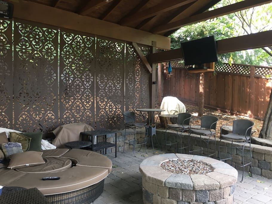 Upper Patio with tv, couch, and firepit