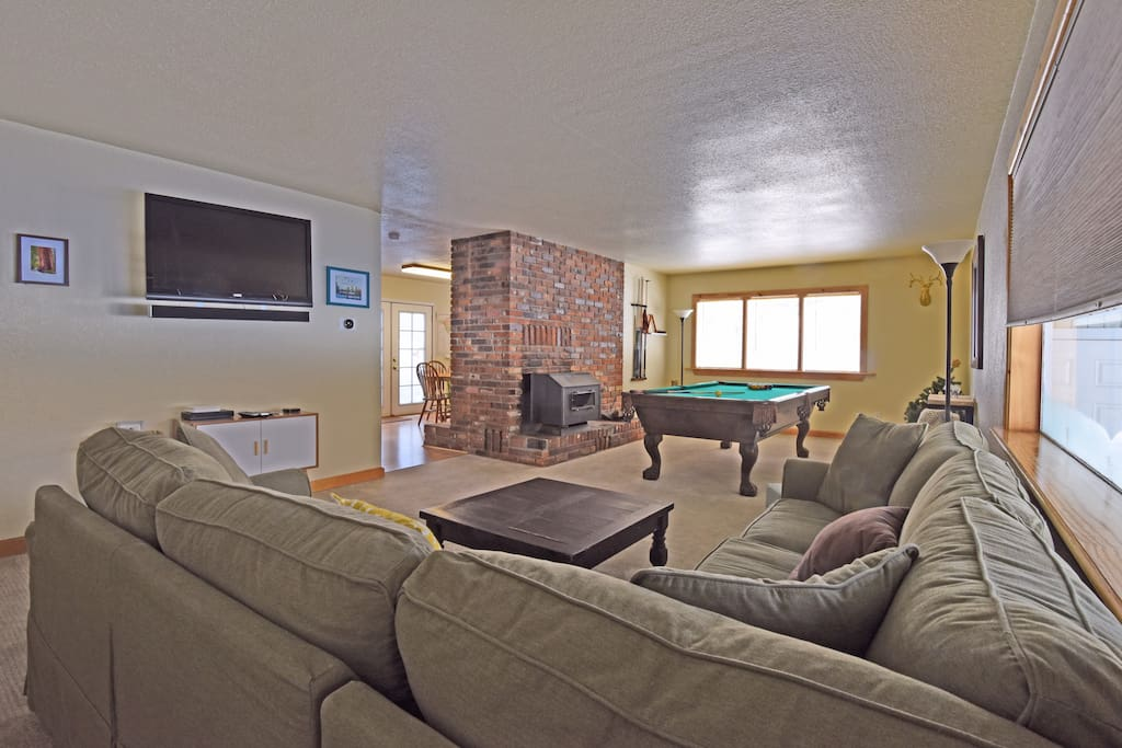 The home is outfitted for plenty of fun, with a great pool table, flatscreen TV, and cozy fireplace