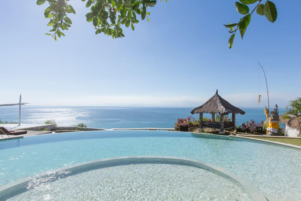 Infinity pool attached with ocean-view restaurant