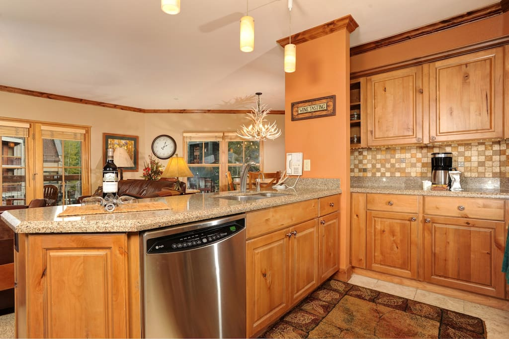 The fully-equipped kitchen features natural wood finishes and plenty of counter space