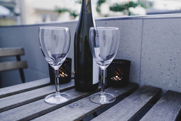 Enjoy a glas of wine on the little balcony.