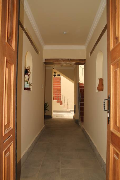 Through front doors into central courtyard