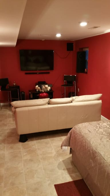 Bedroom Suite; Theatre room feel with Sofa, TV and Bed