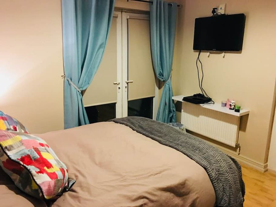 Your cosy bright double bedroom with   32 inch TV