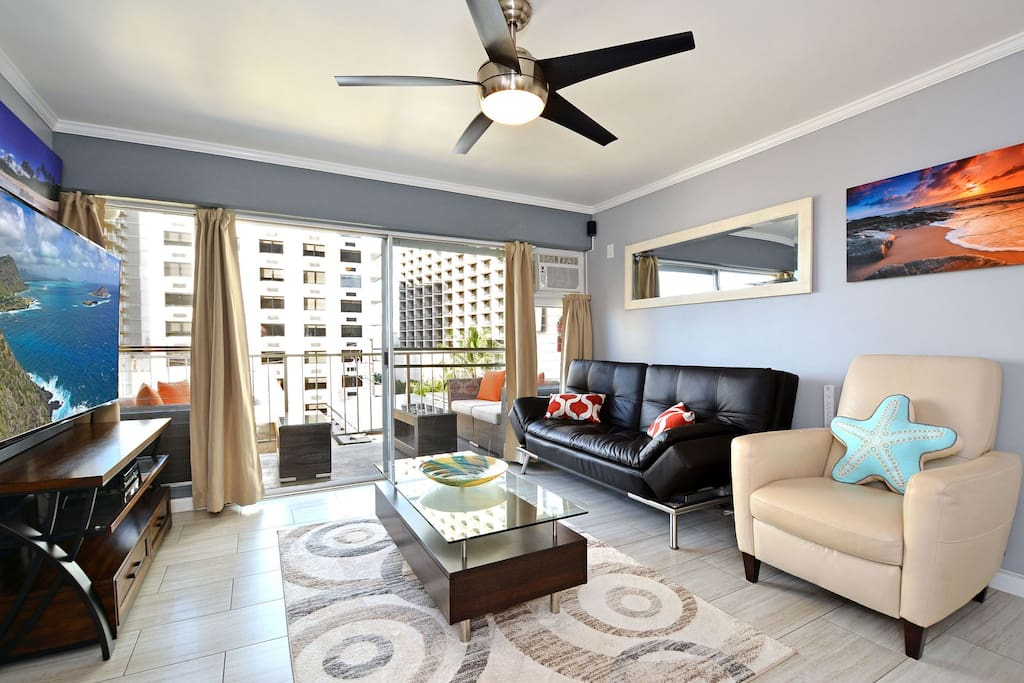 The unit is across the road from the Marriott Hotel and is very close to the beach.There are two love seats on the lanai that is directly off from the living room. The sofa folds flat into a full-sized bed. The white chair is a recliner.