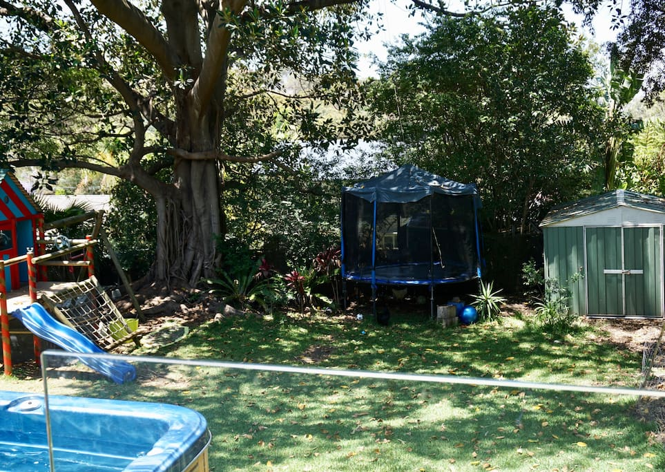 Garden with spa, cubby house, swing & trampoline