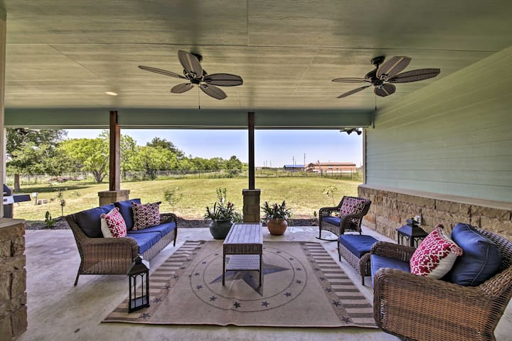 Chill out on the patio at this 4-bedroom, 3-bath Del Valle vacation rental!