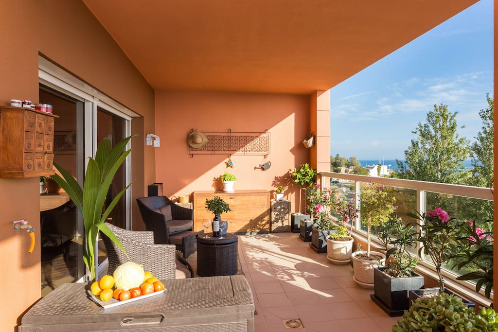Sunny south facing balcony with sea view and dining area