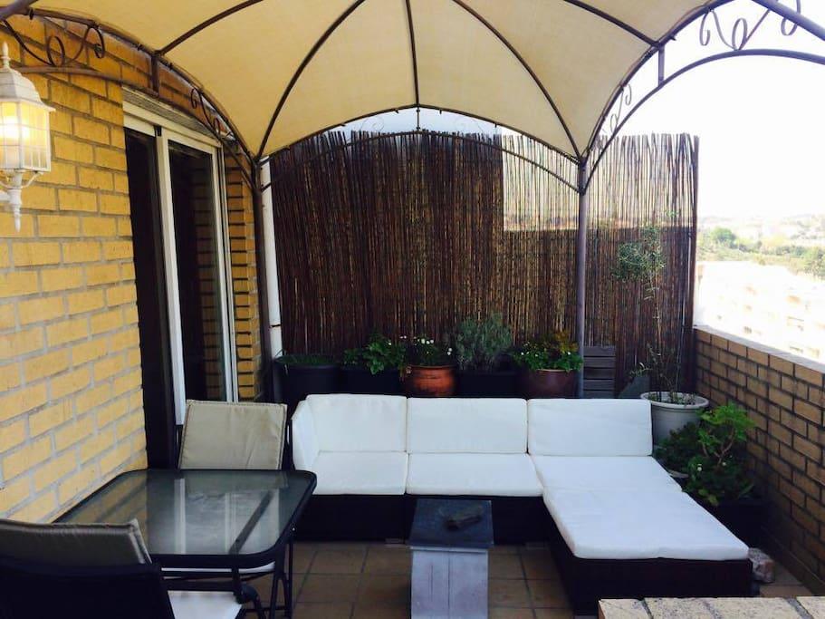 Lounge terrace sofa and exterior eating area, sunrise position.