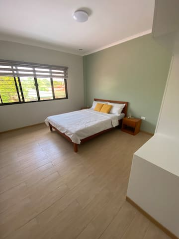 Master's bedroom- Queen size bed, work/study nook, split-type aircondition, and spacious cabinet.
