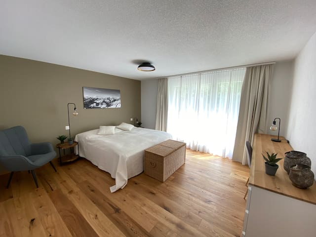 The master bedroom has enough space to have an additional babybed - if needed. From this bedroom, you have access to the garden.