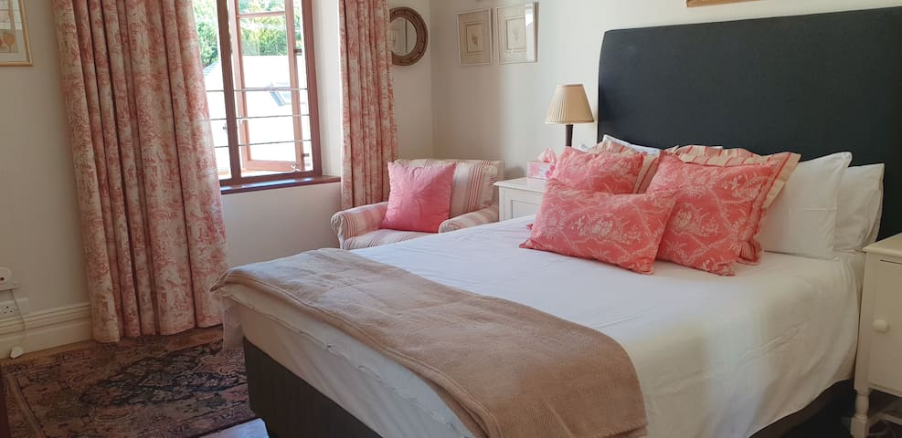 Bedroom with extra length queen size bed