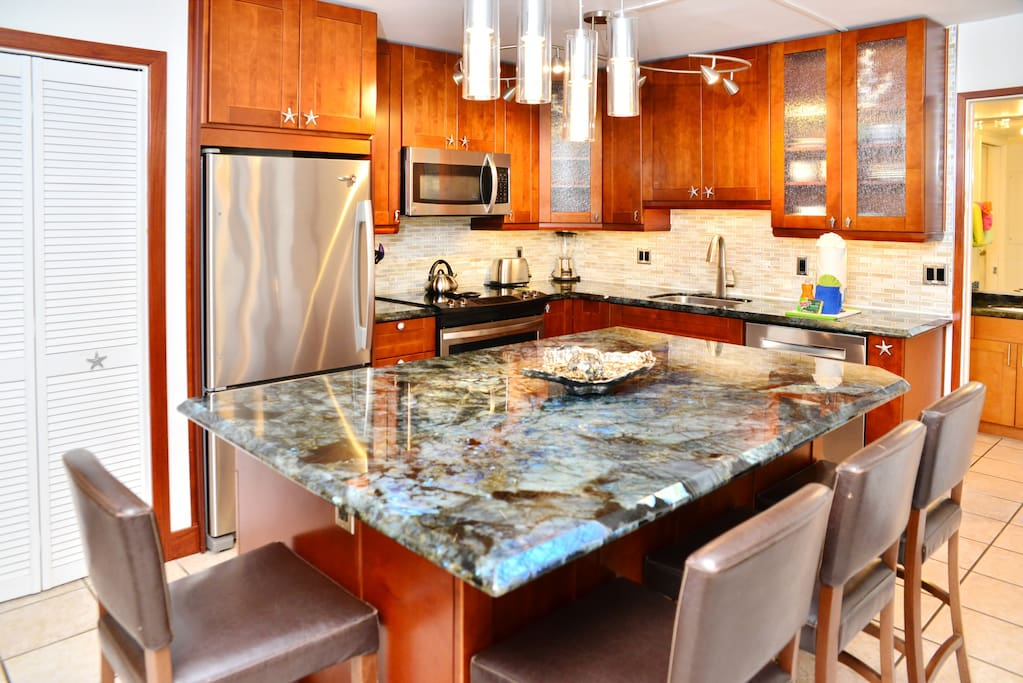 Complete, stunning kitchen remodel. Huge entertaining island with tons of storage and kitchen equipment.
